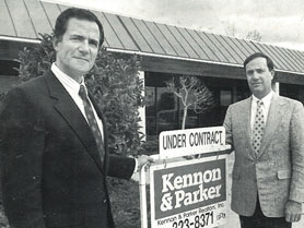 Kelsey Kennon and Dan Parker display the new Kennon & Parker Yard Sign after their merger in 1987